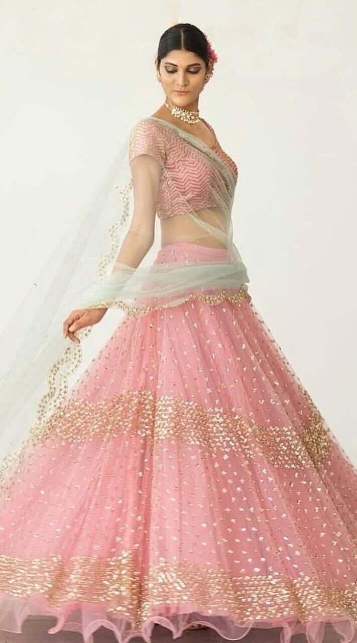 94d2c50636 Appealing Pink Net Crop Top Lehenga Choli for Ring Ceremony
