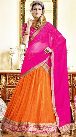 Navratri Chaniya Choli In Orange Color And Soft Net Fabric