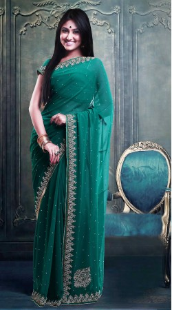 Fashionable Stone Work Teal Faux Georgette Exclusive Saree ZP0804