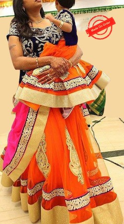 Mesmeric Orange Net Mother Daughter Designer Lehenga Choli BP4016