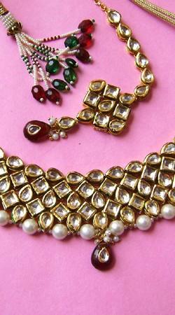 N001896 Striking Maroon Kundan Necklace Set with Tika