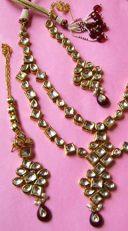 N002896 Charming Maroon Kundan Necklace Set with Tika